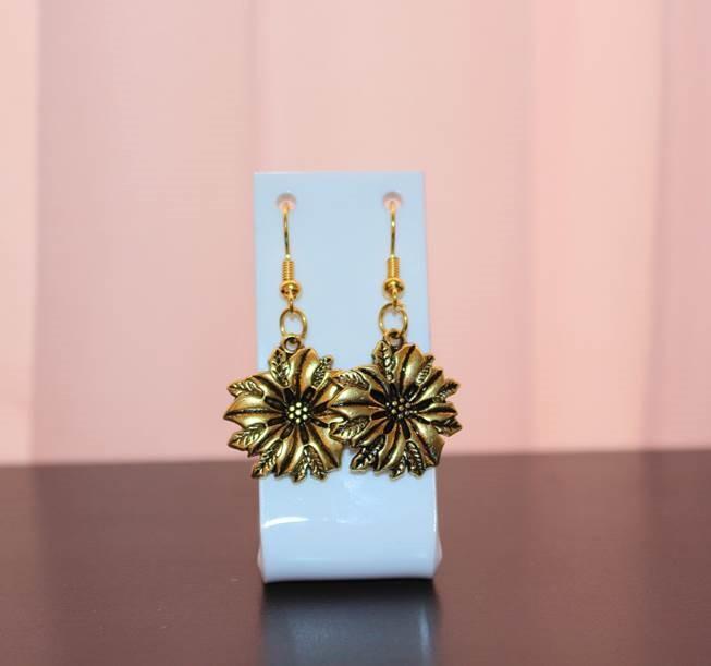 price of Golden flowers earrings on ShopHub | ecommerce, price check, start a business, sell online